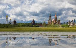 View from the hill of the Zaryadye park on church Ivan the Great Bell Tower and reflections. Cloudy weather with thunderclouds on stock photos