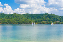 Summer view of a local lake with sailboats in Kentucky, USA Royalty Free Stock Image