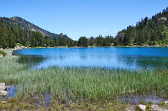 Summer view of the mountainous lake in Pyrenees Stock Image