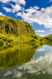 Summer view of the mountains reflected in a lake stock images
