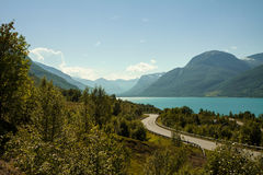 Norwegian fjord. Summer view of Norwegian fjord. Mountain, sea, road Stock Photos