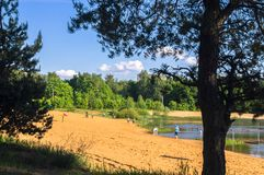 Summer View Of The Sandy Lakeshore In Suburban Residential District. Stock Photos