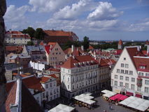 Summer view of the Old Town of Tallinn, Estonia. Summer view of the central square, towers and tiled roofs of ancient houses in the Old Town of Tallinn, Estonia Stock Photography