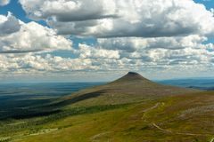 Summer view over the northern Swedish mountains. Beautiful summer view from one of the peaks, over the Swedish mountains or fjeld word in Northern Sweden with royalty free stock photography