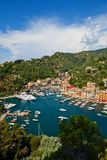 Summer view of Portofino town. Summer view of Portofino harbor and town from castle Brown Royalty Free Stock Image