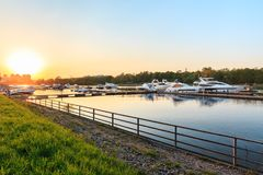 Summer view of river bank and superyachts in sunshine. royalty free stock photography
