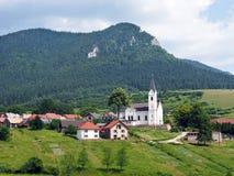 Church and hill in Valaská Dubová Royalty Free Stock Photography
