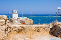 Summer view of sea through barbed wire from fortress Othello. Famagusta. Northern Cyprus Royalty Free Stock Photo