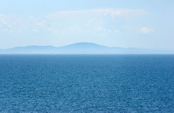 Summer view of the sea and mountain range Stock Photography