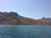 Summer view seacoast. Warm sea and beautiful nature. Black Sea, Crimea Stock Photos
