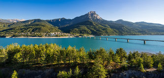 Summer view of Serre-Poncon Lake with Savines-le-Lac and the Grand Morgon mountain peak. Alps, France Stock Images