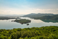 Summer view of the Slansko Lake. With islands near Niksic town, Montenegro Royalty Free Stock Photo