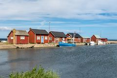 Summer view of a small fishing camp at the east coast of Oland. Summer view of a small fishing town on the east coast of Oland, with some small fishing boats and Stock Photography