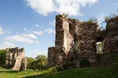 Summer view to castle ruins in Buchach with beautiful sky and clouds, Ternopil region, Ukraine. Buchach castle ruins, Ternopil region, Ukraine. Dating to 14th Stock Photos