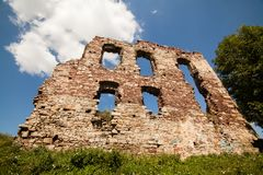 Summer view to castle ruins in Buchach with beautiful sky and clouds, Ternopil region, Ukraine. Buchach castle ruins, Ternopil region, Ukraine. Dating to 14th Royalty Free Stock Photography