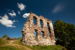 Summer view to castle ruins in Buchach with beautiful sky and clouds, Ternopil region, Ukraine. Buchach castle ruins, Ternopil region, Ukraine. Dating to 14th Royalty Free Stock Image