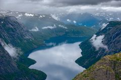 The summer view of Trolltunga in Odda, Ringedalsvatnet lake, Norway Royalty Free Stock Image