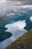 The summer view of Trolltunga in Odda, Ringedalsvatnet lake, Norway Royalty Free Stock Photo