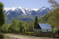 Summer view valley and rural small house. Alpine landscape. Royalty Free Stock Image