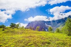 Summer view of volcano on Kamchatka, under blue sky with clouds royalty free stock photo