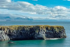 Summer view of the west coastline of Iceland. View of the west coastline of Iceland with a steep edge of lava cliffs down to the turquoise ocean below stock photography