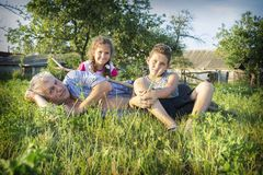 In the summer in the village in the garden on the grass is grand stock photos