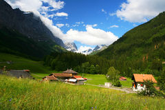 Summer village of swiss alps Stock Photo