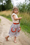 Summer walk. Little beautiful blonde girl with wild flowers stock photos
