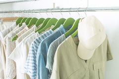 Free Summer Wardrobe With Linnen Clothes On Green Hangers Stock Photography - 154253842