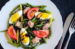 Warm salad with green beans, tuna, tomatoes and boiled eggs Royalty Free Stock Image