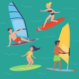 Summer water beach extreme sports. Windsurfing. Summer water beach sports, activities. Board with a sail. Men and women standing on the board learning to Royalty Free Stock Images