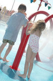 Summer Water Park 4. Kids play with the buttons at a water park Stock Images