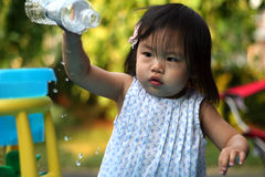Summer Water Play. Toddler playing with her water table in the heat of the summer royalty free stock photo