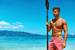 Summer Water Sport. Man With Canoe Kayak Paddle On Beach Stock Images