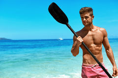 Summer Water Sport. Man With Canoe Kayak Paddle On Beach Stock Photos