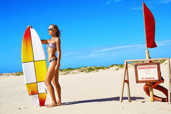Summer Water Sports. Beach Vacation. Surfing. Woman In Bikini. Summer Water Sports. Beach Vacation. Surfing. Beautiful Fit Smiling Surfer Woman With Body In royalty free stock photography