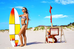 Summer Water Sports. Beach Vacation. Surfing. Woman In Bikini. Summer Water Sports. Beach Vacation. Surfing. Beautiful Fit Smiling Surfer Woman With Body In stock photography