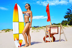 Summer Water Sports. Beach Vacation. Surfing. Woman In Bikini, Surfing. Summer Water Sports. Beach Vacation. Surfing. Beautiful Fit Smiling Surfer Woman With stock photo
