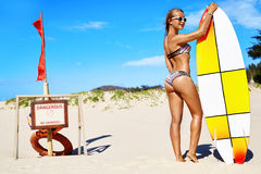 Summer Water Sports. Beach Vacation. Surfing. Woman In Bikini, Surfing. Summer Water Sports. Beach Vacation. Surfing. Beautiful Fit Smiling Surfer Woman With royalty free stock photography