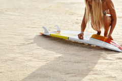 Summer Water Sports. Surfing. Beach. Woman Waxing Surfboard Stock Images
