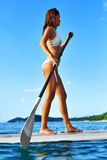 Summer Water Sports. Woman Paddling On Surfboard. Healthy Active Royalty Free Stock Photos