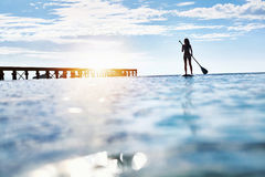 Summer Water Sports. Woman Silhouette In Sea. Healthy Lifestyle. Summer Water Sports. Silhouette Of Free Fit Woman Paddling, Stand Up On Paddle, Surf Board In Stock Images