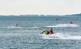 Summer water sports on Zemplinska Sirava lake. Slovakia. Lovely place for vacation or weekend in summer. people have fun while water skiing and riding water Royalty Free Stock Photo