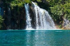 Summer waterfalls in Plitvice (Croatia). Beautiful waterfall and sea-green limpid lake in Plitvice Lakes National Park (Croatia Royalty Free Stock Photo