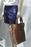 Summer wear, carrying bag. Dermis bags in the shop Stock Photos