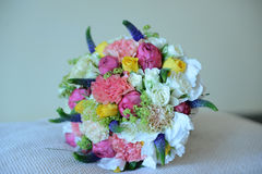 Summer wedding bouquet for the bride-to-be. Lush and vintage looking wedding bouquet including a floral-fruity mix, strong colors and greenery accents Stock Images