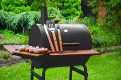 Summer Weekend BBQ Scene With Charcoal Grill On The Backyard royalty free stock images