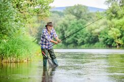 Free Summer Weekend. Big Game Fishing. Man Fly Fishing. Man Catching Fish. Hobby And Sport Activity. Pothunter. Retired Stock Photos - 176465253