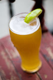 Summer wheat beer with lime stock photos
