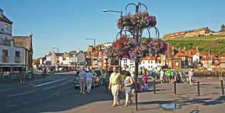 Summer in Whitby. Floral decoration in street at the scenic  resort of Whitby on the coast of East Yorkshire Royalty Free Stock Photography